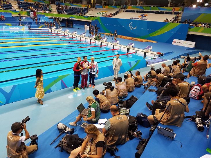 The medal ceremony was covered by reporters from all over the world
