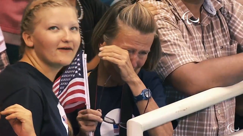Molly and her mom as they watch Robert win the bronze