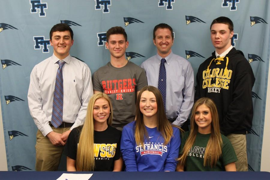 At the D1 signing with Mr. McEvoy, these FTHS athletes commit themselves to colleges across the nation