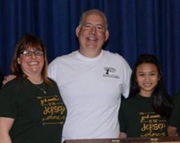 Justine Nguyn with two officials from the Girl Scouts