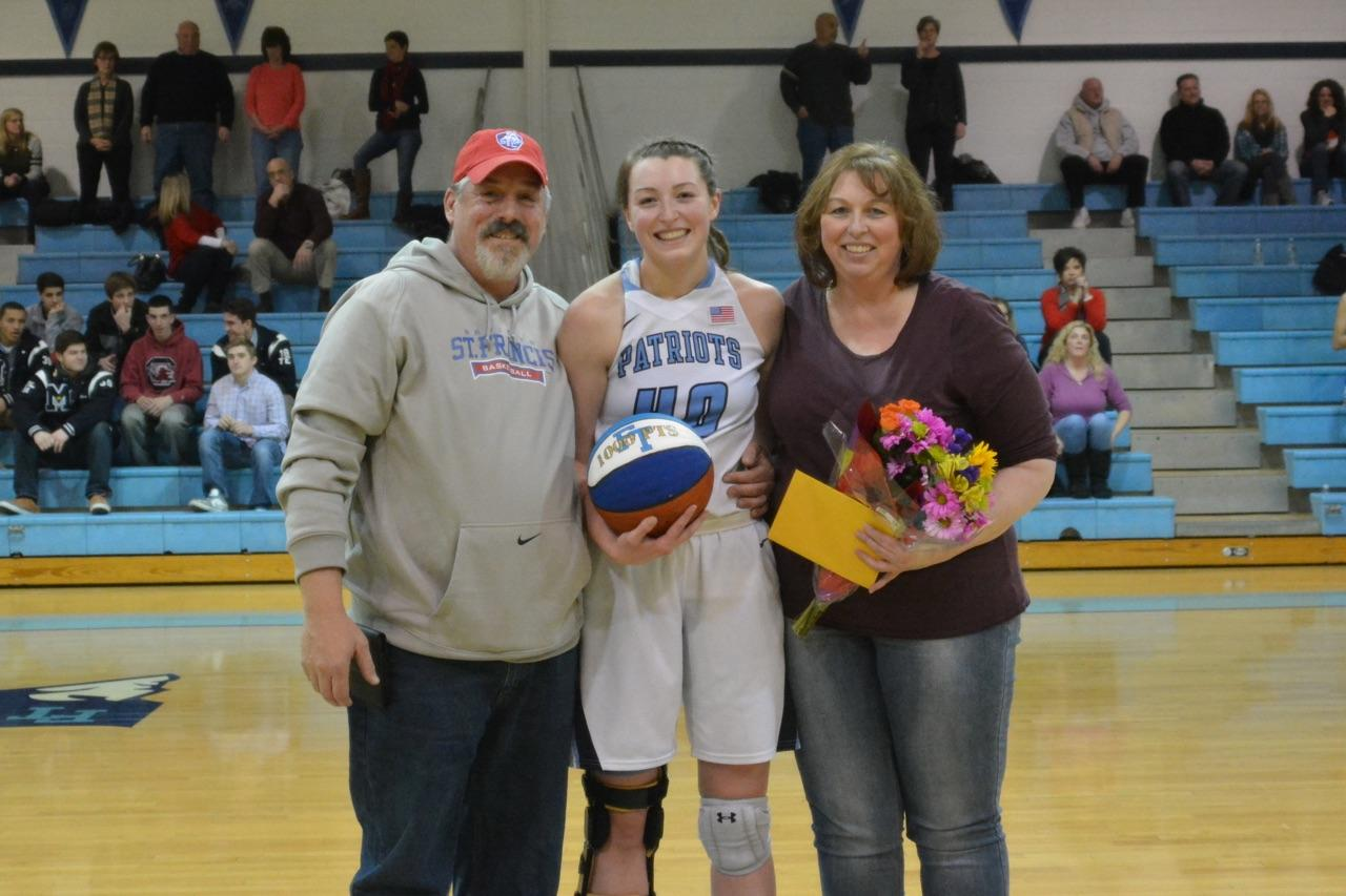 Tori with her parents after scoring her 1000th career point