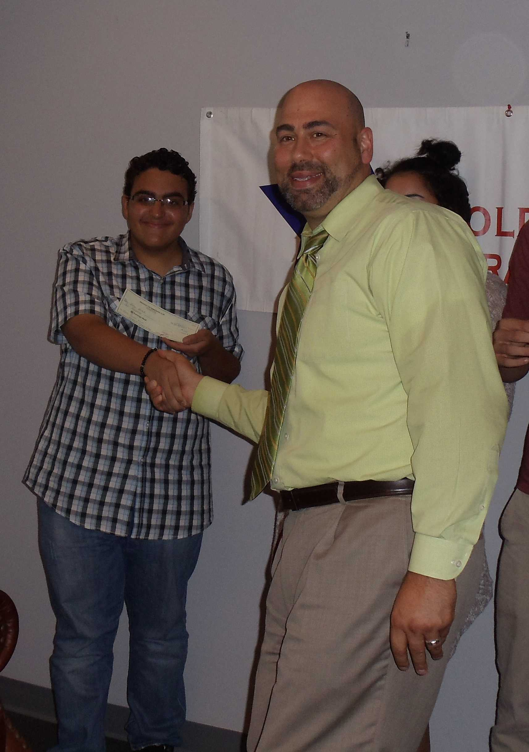 Tommy Malek receiving his prize for his third place entry by a representative from the  Freehold Democratic Club.