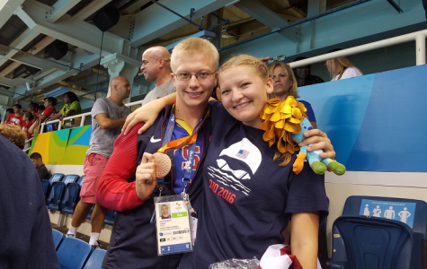 Robert and Molly Griswold showing off his bronze medal in Rio