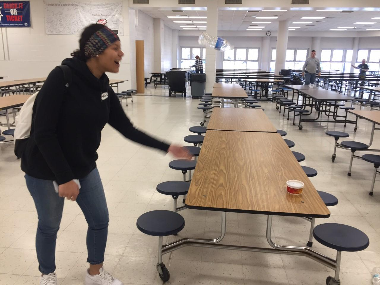Senior Cihara Coleman demonstrates her bottle-flipping skills in the cafeteria