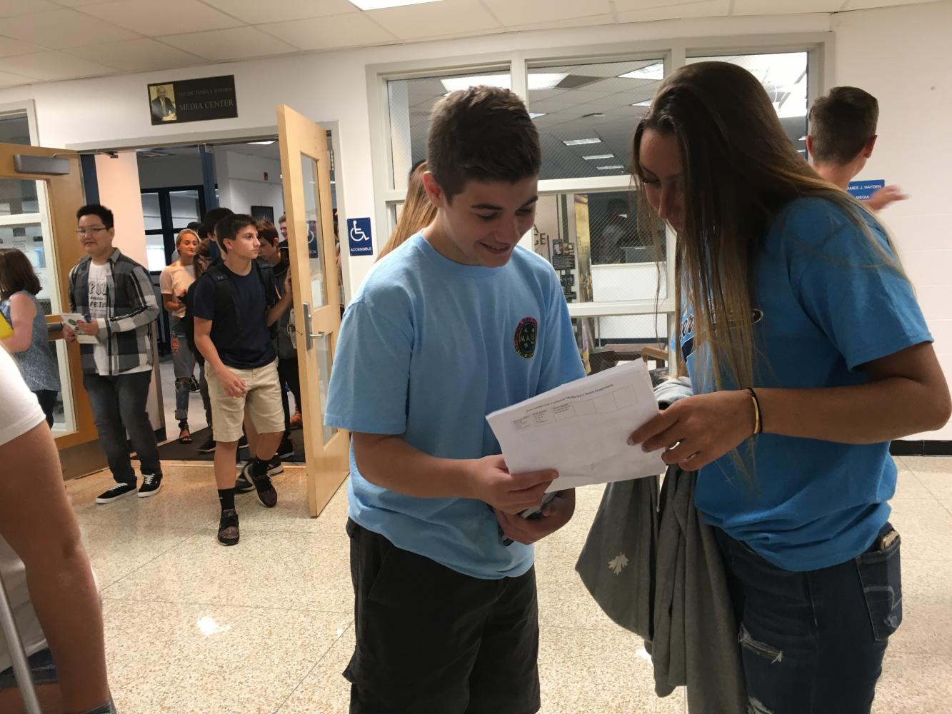 One of the FTHS Peer Leaders helps out a freshmen during Freshmen Orientation
