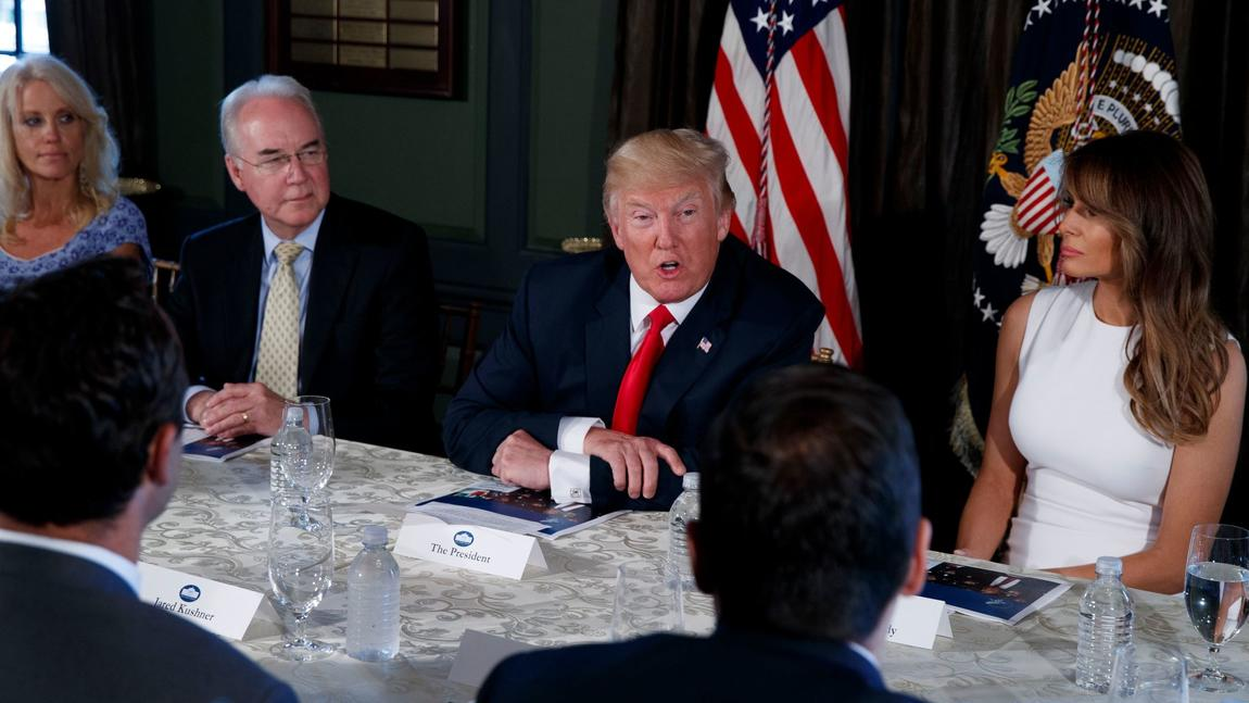 President Trump with Former US Secretary of Health and Human Services Tom Price (left) and First Lady Melania Trump (right), discussing opioid abuse in a briefing in Bedminster, New Jersey.